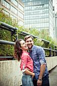 Affectionate couple outdoors, portrait
