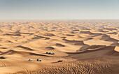 Offroad vehicles on sand dunes near Dubai, United Arab Emirates, Middle East