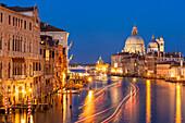 Grand Canal, and the church of Santa Maria della Salute, at night, with boat light trails, Venice, UNESCO World Heritage Site, Veneto, Italy, Europe