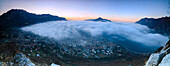 Panoramic of fog at sunrise above the city of Lecco seen from Monte San Martino, Province of Lecco, Lombardy, Italy, Europe