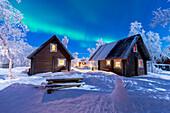 Northern Lights over houses of Abisko, Abisko, Abisko National Park, Norbottens Ian, Sweden,Europe