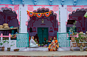 'Jodhpur, Rajasthan, India, Women relax before dinnertime in the streets of Jodhpur, also known as ''The Blue City'' for the color of its buildings'