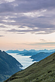 Along the Grossglockner alpine road, panorama to the valley covered by the clouds, in the distance the Berchtesgaden Alps, Fusch an der Grossglocknerstrasse, Austria