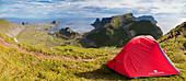 Panorama of tent on mountain ridge overlooking the sea Sorland Vaeroy Island Nordland county Lofoten archipelago Norway Europe