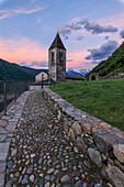 Dawn on stone footpath leading to Xenodochio of Santa Perpetua, Tirano, province of Sondrio, Valtellina Lombardy, Italy, Europe