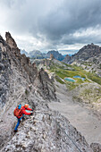 'Sesto / Sexten, province of Bolzano, Dolomites, South Tyrol, Italy, Climber on the via ferrata ''De Luca-Innerkofler'' to the Mount Paterno'