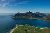 View over beaches and village of Flakstad from Flakstadtind mountain peak, Flakstadøy, Lofoten Islands, Norway