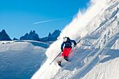 Andrea Binning skiiing through fresh powder down a steep mountainside. Chamonix, France