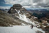 Front view of hiker hiking in Mount Allen, Banff, Alberta, Canada
