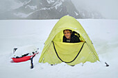 A portrait of mountaineer and climbing ranger Shane Treat in a tent on the slopes of Denali in Alaska.