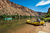Two People Loading The Raft Near The Glen Canyon Dam In The Grand Canyon