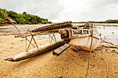 'Wooden canoe with carved spirit figures. Canoes are traditionally decorated with clan symbols and other emblems of power to insure speed and success. In New Guinea, a canoe is like a car; it provides transportation and more. A canoe with a beautiful prow