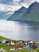 Village Funningur , in the background Funningsfjordur, Leiriksfjordur and the island Kalsoy. The island Eysturoy one of the two large islands of the Faroe Islands in the North Atlantic. Europe, Northern Europe, Denmark, Faroe Islands.
