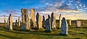 Panorama of Calanais Standing Stones central stone circle erected between 2900-2600BC measuring 11 metres wide. At the centre of the ring stands a huge monolith stone 4. 8 metres high weighing about 7 tonnes, which is perfectly orientated so that its wide