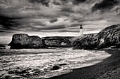 A B&W of the picturesque Yaquina Bay Lighthouse in Newport, Oregon.