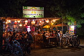 People enjoy dinner at Weather Spoon's Bagan restaurant and bar at night, Nyaung-U, near Bagan, Mandalay, Myanmar