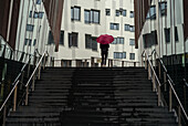 Woman with umbrella in Speicherstadt, Hamburg, Germany.