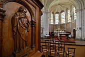 France, Western France, Vendee, Interior view of the Church of the Copechaniere. Wooden sculpture in the foreground. Choir and altar in the background