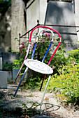 France, Paris 20th district. Pere Lachaise cemetery. A chair grave