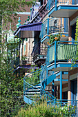 Canada, Province of Quebec. Montreal. Plateau Mont Royal district. Rachel street. Outdoor wrought iron staircases