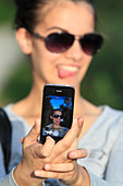 Young woman taking a selfie with her smartphone.