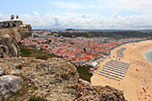 Portugal, Nazare. Nazare beach and its beach tents.