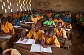 A classroom full of students learning at a primary school in Ghana, West Africa, Africa