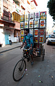 Piled up empty oil tins, being carried by cycle rickshaw to be recycled and used for slum house walls, Kolkata ,Calcutta, West Bengal, India, Asia