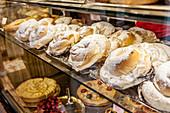 ' Traditional Mallorquin pastry from Pastisseria Ca na Cati; ensaimadas, Old town, Palma de Mallorca, Majorca, Balearic Islands, Mediterranean Sea, Spain, Europe'