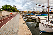 Luxury yachts and bicyclist at the port of Mallorca. Puerto de Palma, Port of Palma, Palma, Mallorca, Spain, Europe