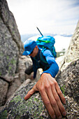 Photograph of male backpacker climbing Needle Peak, Hope, British Columbia, Canada