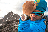 Photograph of mountain climber showing smart watch with summit elevation, Chilliwack, British Columbia, Canada