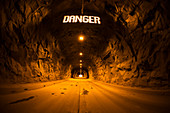 Photograph of tunnel in cave with Danger sign, Inspiration Point, Yosemite National Park, California, USA