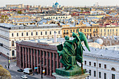 Photograph with aerial view of St. Petersburg and statue from colonnade of St. Isaac Cathedral, Russia