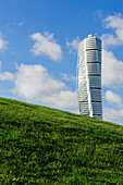 Turning torso with green meadow in the rehabilitated harbor area, Malmo Southern Sweden, Sweden