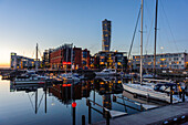 Yachthafen in the evening light, Turning torso in the Sanierungshafenareal, Malmo, Southern Sweden, Sweden