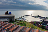 Young people drinking wine. View from the St. Ibb church on the island of Ven, Skane, Southern Sweden, Sweden