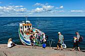 ' Transit with tourists to granite rocks Bla Jungfrun at Byxelkrok, The uninhabited Swedish island of Blå Jungfrun (''Blue Virgin'') is located in northern Kalmarsund, between the Baltic Sea coast of Sweden and the northern tip of the island of Öland., Sc