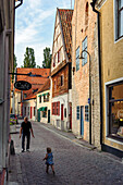 Man with toddler in the streets of the old town, Schweden