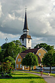 Church of Mariefred and wife with dog in the foreground, Sweden
