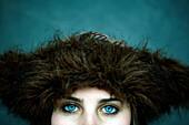 Eyes of Caucasian woman wearing fur hat
