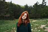 Caucasian woman wearing coat in field