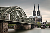 UNESCO World Hermitage Cologne cathedral and Hohenzollern Bridge across the river Rhine, Germany