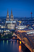 UNESCO World Heritage Cologne cathedral at dusk, Hohenzollern Bridge across Rhine River, Cologne, North Rhine-Westphalia, Germany