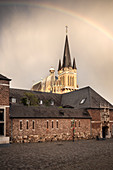 UNESCO World Heritage rainbow after thunderstorm above Aachen Cathedral, Aachen, North Rhine-Westphalia, Germany