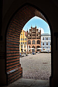 UNESCO World Heritage Hanseatic city Stralsund, view through gothic brick archway towards market square, Mecklenburg-West Pomerania, Germany, Baltic Sea