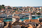Overhead of Old Town rooftops and boats in harbor seen from bell tower of Cathedral of St. Lawrence, Trogir, Split-Dalmatia, Croatia