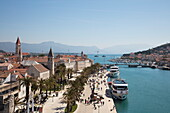 Overhead of Old Town rooftops and cruise ships Casanova and MS Romantic Star (Reisebüro Mittelthurgau) docked alongside seafront promenade seen from Kamerlengo Castle, Trogir, Split-Dalmatia, Croatia