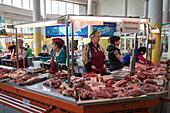 Women sell meat at Yaroslavl market, Yaroslavl, Russia