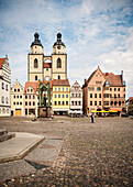 UNESCO World Heritage Martin Luther towns, town church an Statue of Martin Luther at market square at Wittenberg, Saxony-Anhalt, Germany